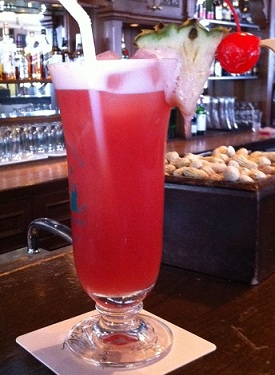 Drinking a Singapore Sling at the Raffles Hotel