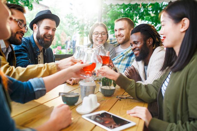 Diverse friends clinking glasses   Bevvy