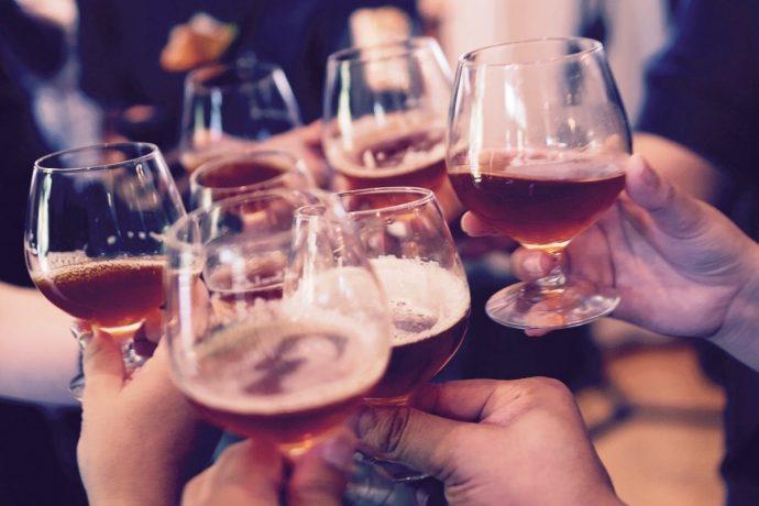 people cheersing at bar