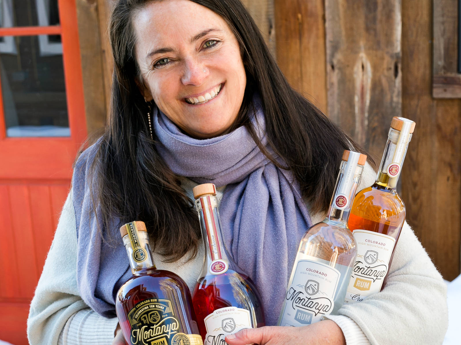 Karen Hoskin of Montanya Distillers, with four Montanya Rum expressions
