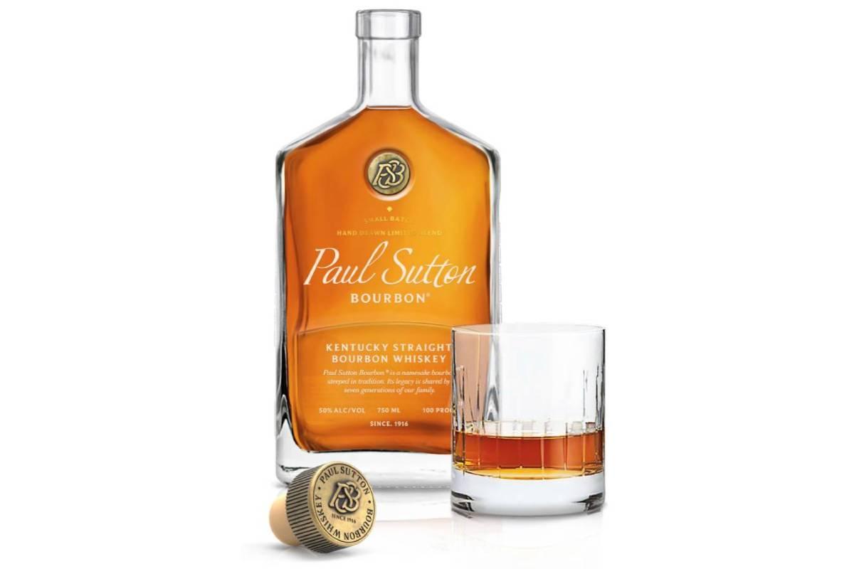 paul sutton bourbon with glass