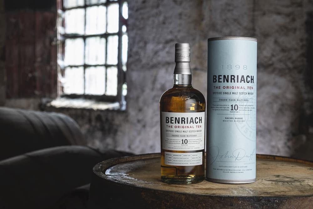 benriach original 10 scotch whisky bottle sitting on a barrel