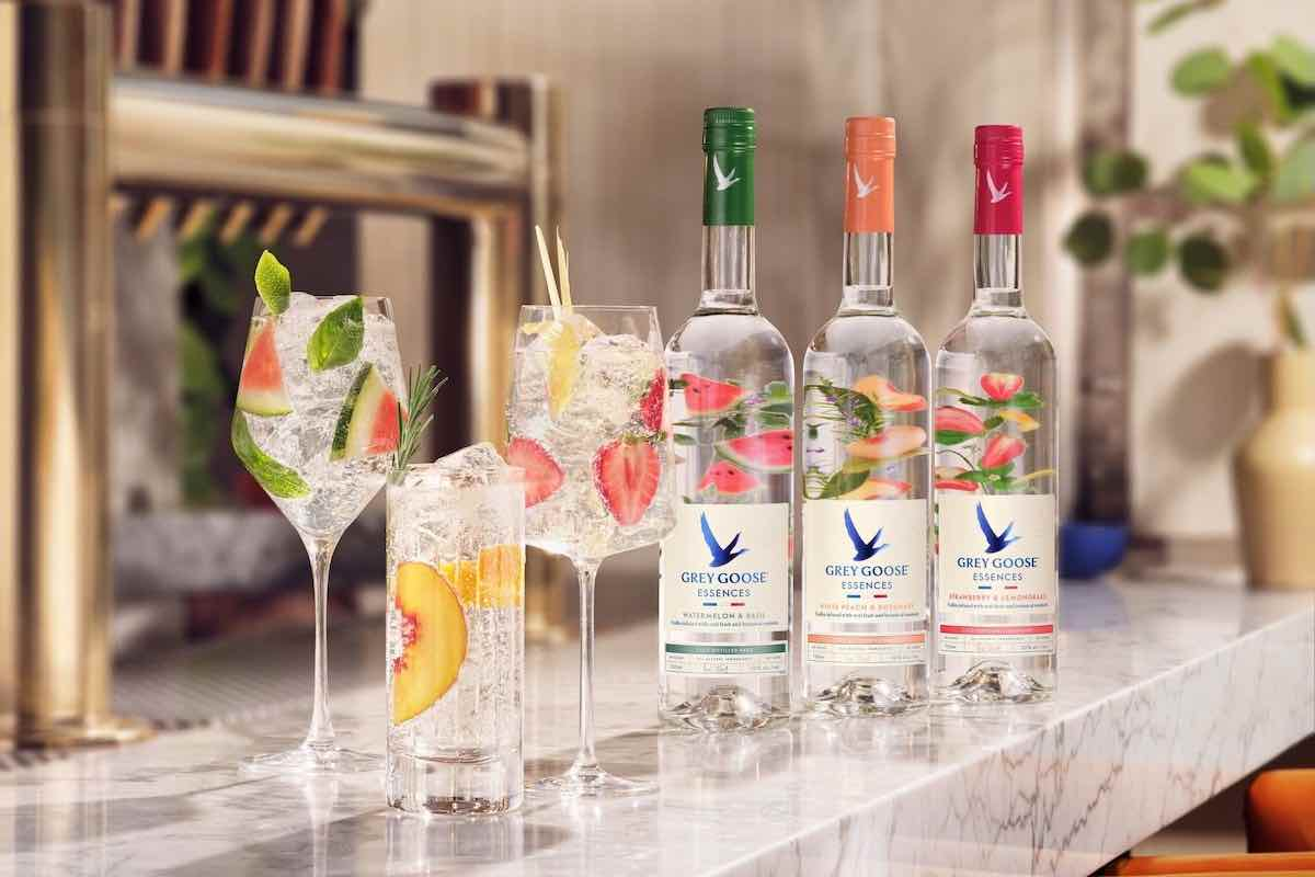 three grey goose essences cocktails with vodka bottles