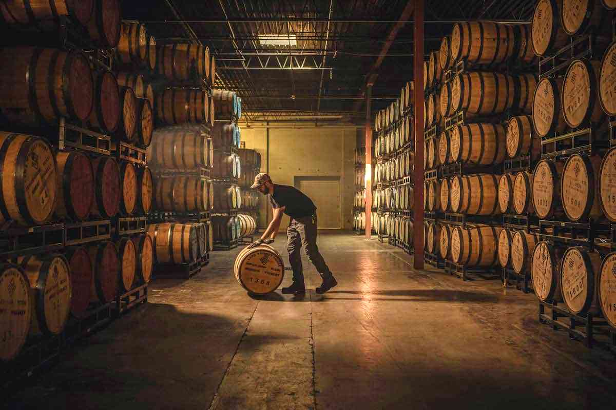 colorado distillery warehouse with whiskey barrels