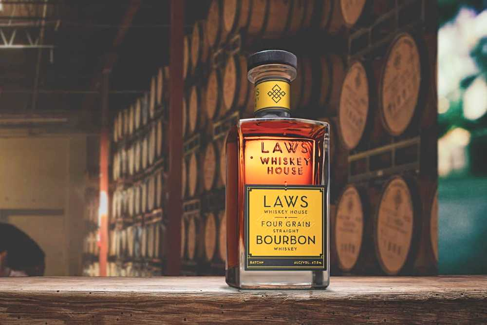 a bottle of Laws Whiskey House four grain bourbon