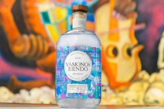 Vamonos Riendo mezcal bottle with colorful mural