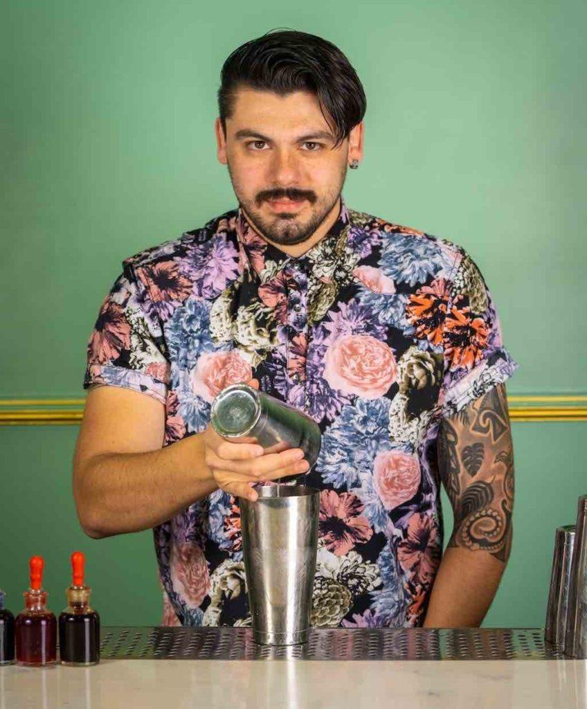 will isaza bartender makes a cocktail at blossom bar.