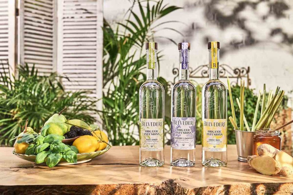3 belvedere organic infusions vodka bottles on a wooden table