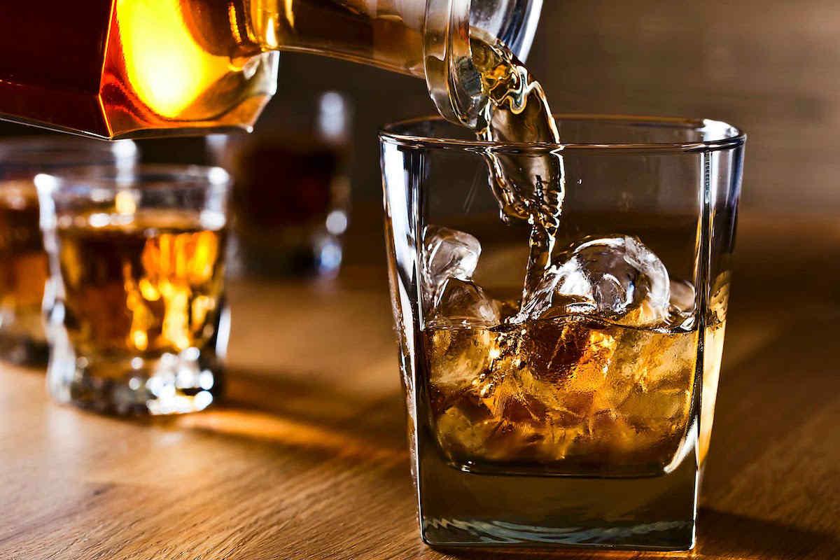 pouring a glass of irish single pot still whiskey