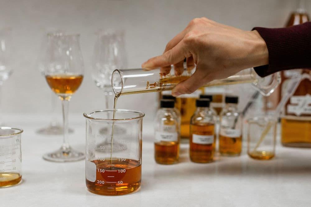 blending barrell whiskey in beakers