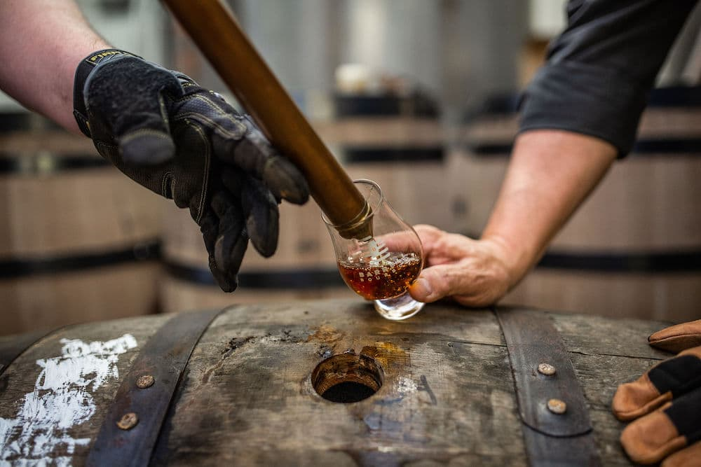 barrell whiskey thief pouring bourbon into a glass