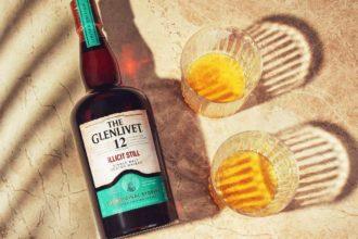 The Glenlivet Illicit Still whisky bottle with two glasses