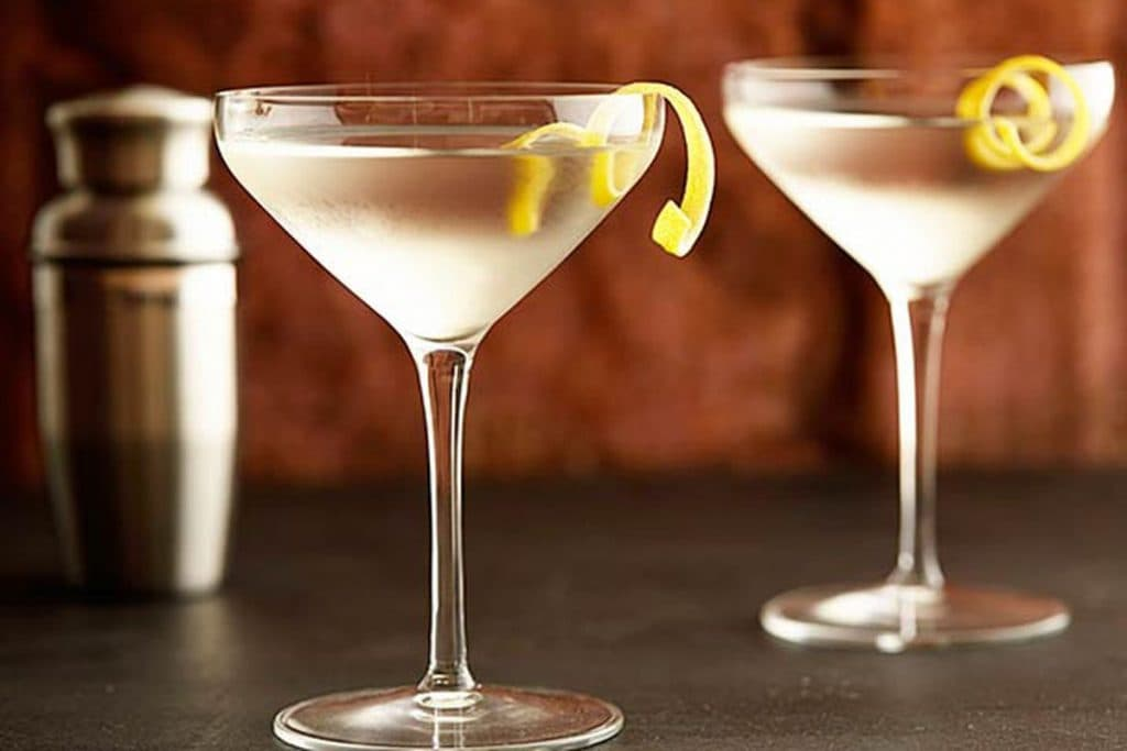 Martini in a cocktail glass with lemon peel garnish