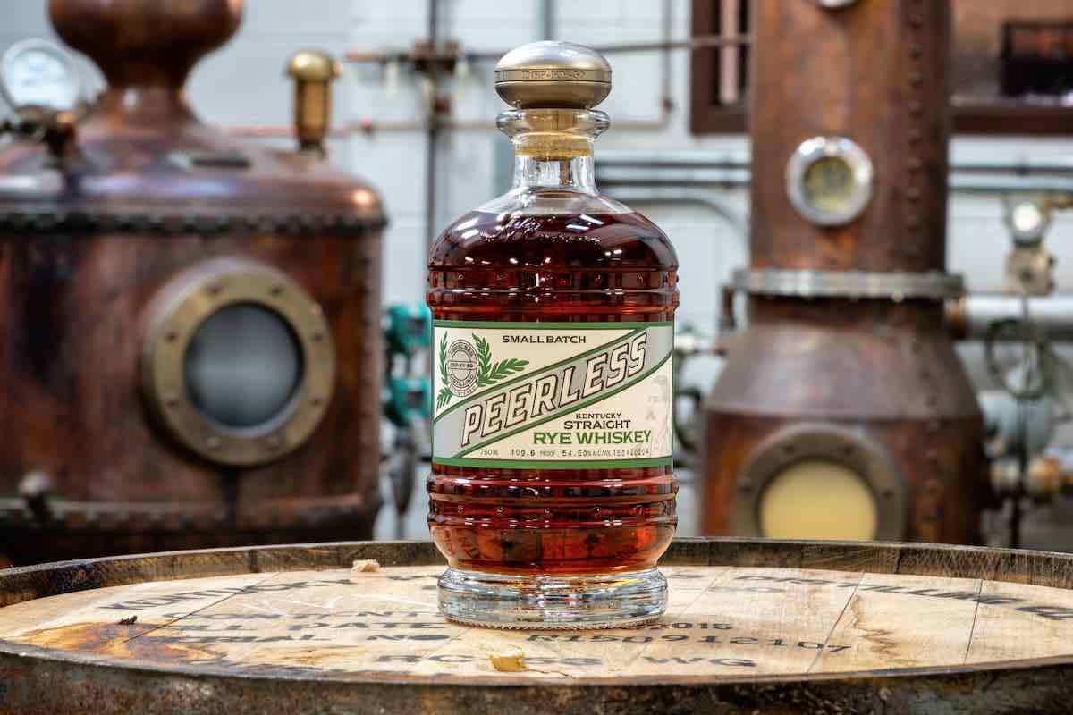 peerless rye whiskey bottle on a barrel