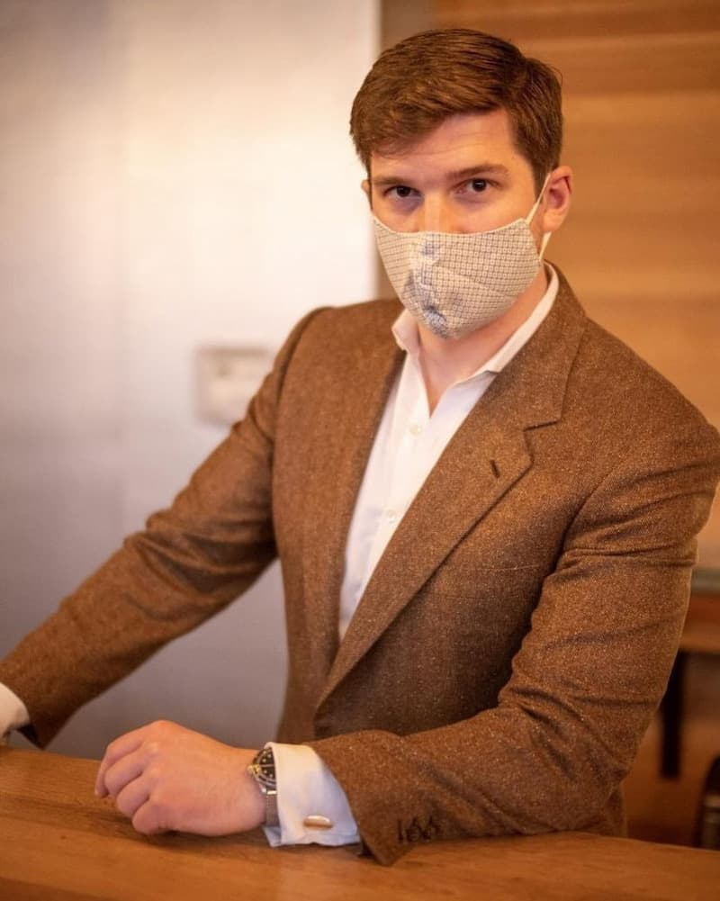 boston bartender Ben Watts in brown jacket and facemask