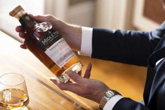 distiller kevin o'gorman holds a bottle of midleton 2021 very rare irish whiskey