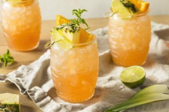 tiki drinks with pineapple garnish