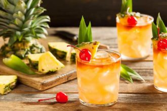 mai tai cocktails with cherry and pineapple garnish
